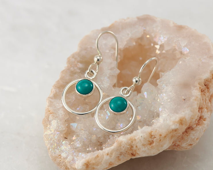 Silver turquoise hoop earrings on crystal rock