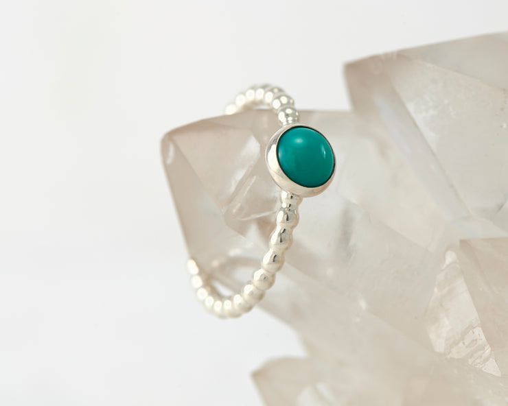 Silver beaded ring on crystal rock