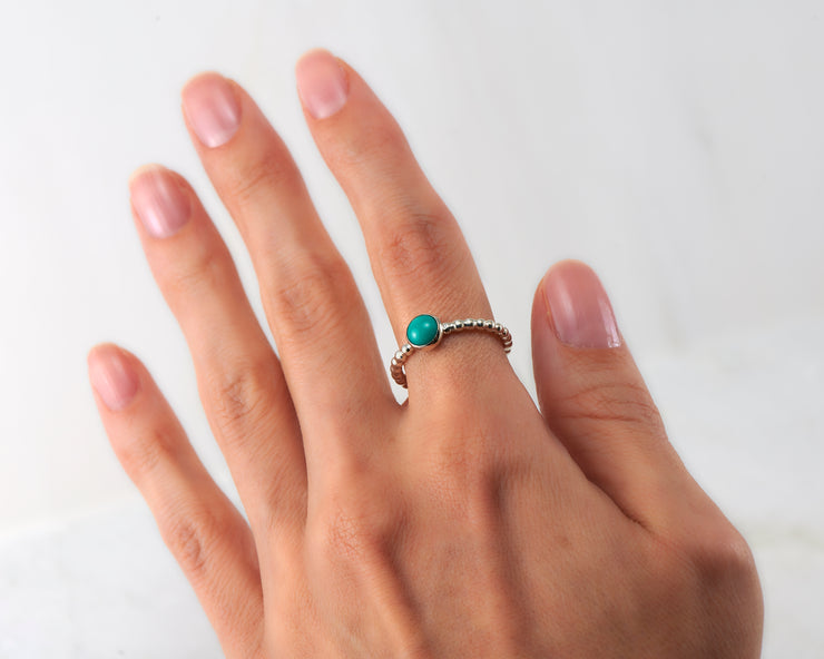 woman wearing turquoise silver ring