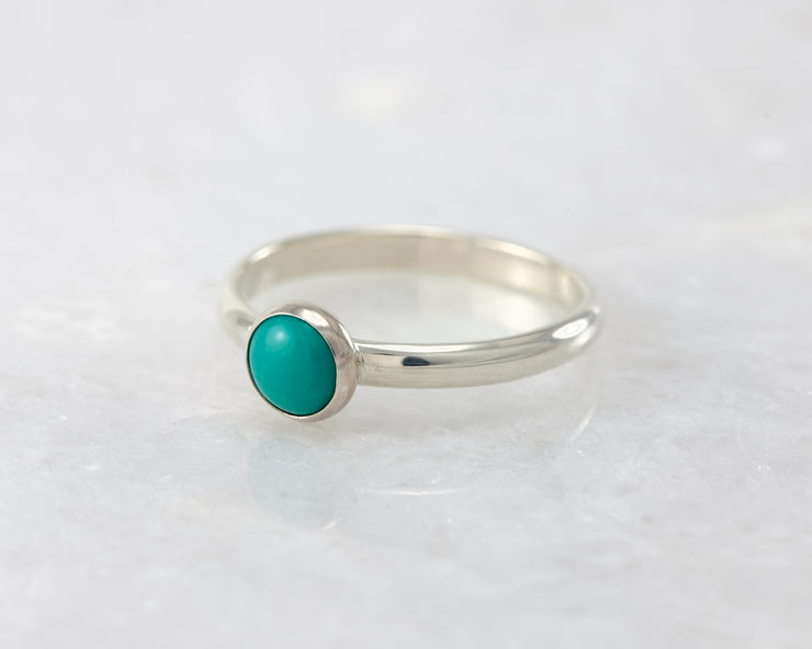 simple turquoise silver ring on white marble