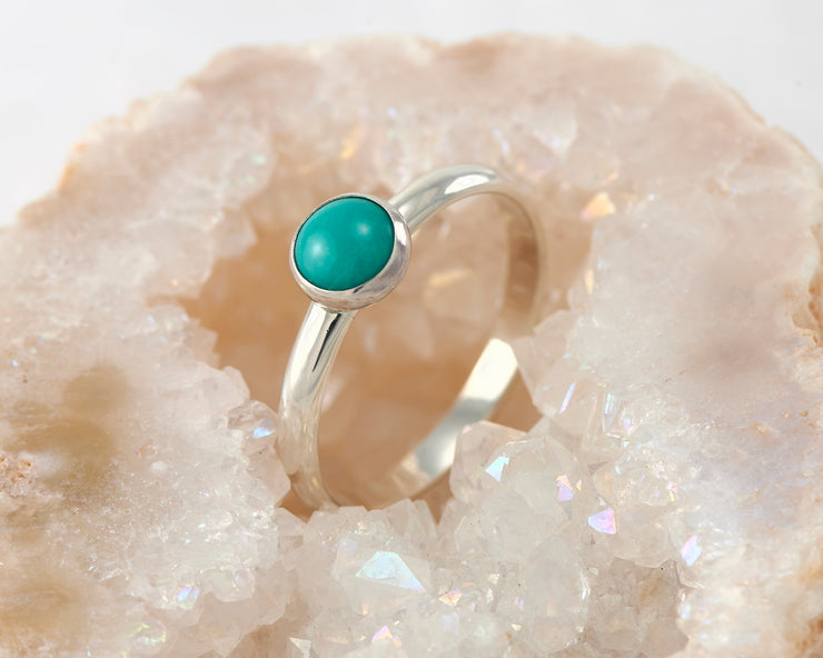 central turquoise ring in quartz
