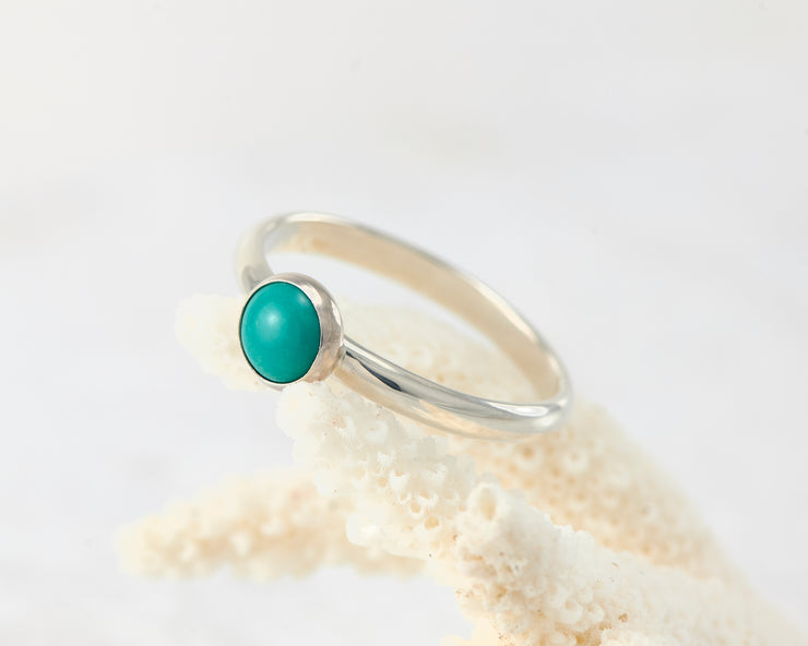turquoise ring on coral