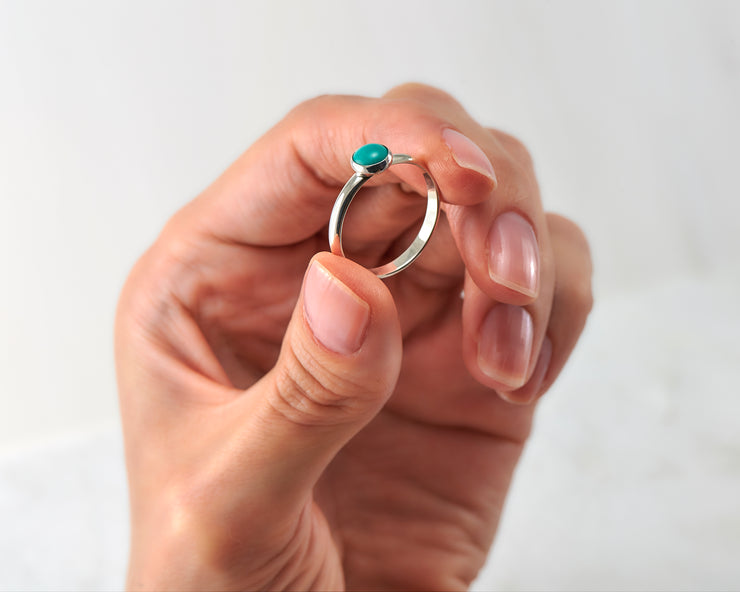 woman holding silver turquoise ring