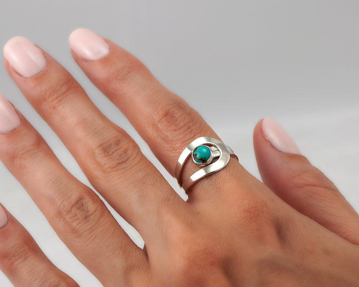 Woman wearing wrap turquoise ring