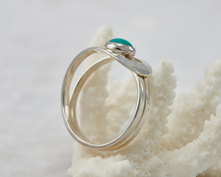 Silver turquoise ring on coral