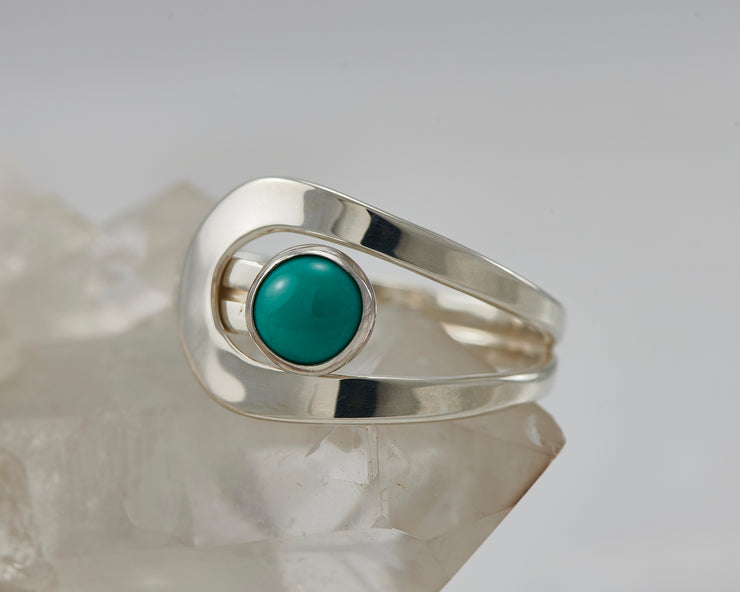 turquoise wrap ring on crystal rock