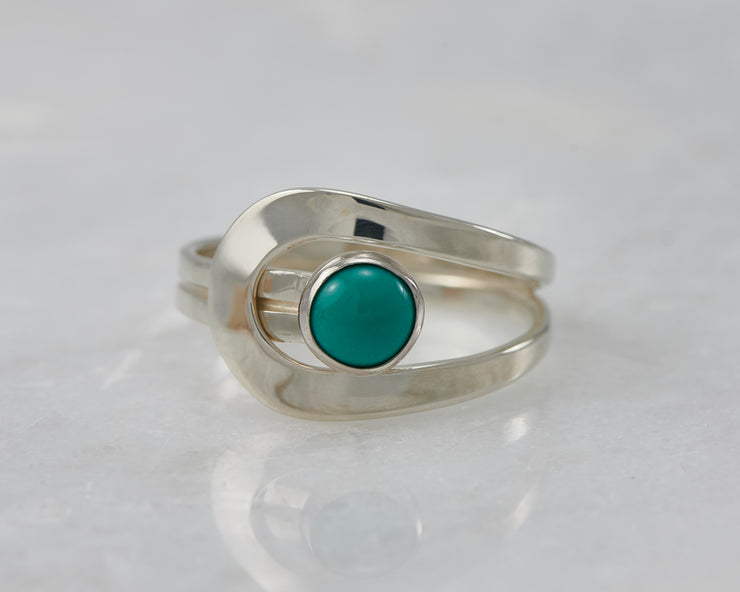 wrap turquoise ring on white marble