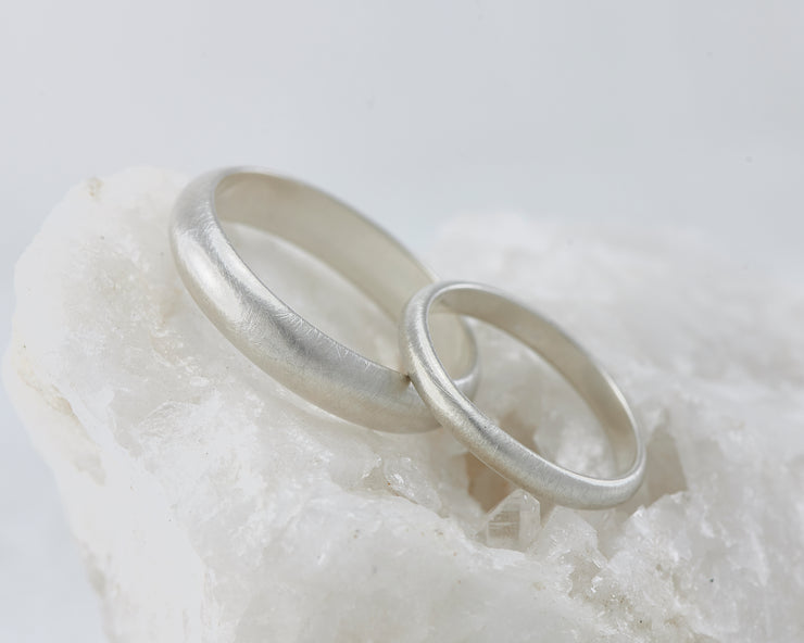 top down view of brushed wedding ring set