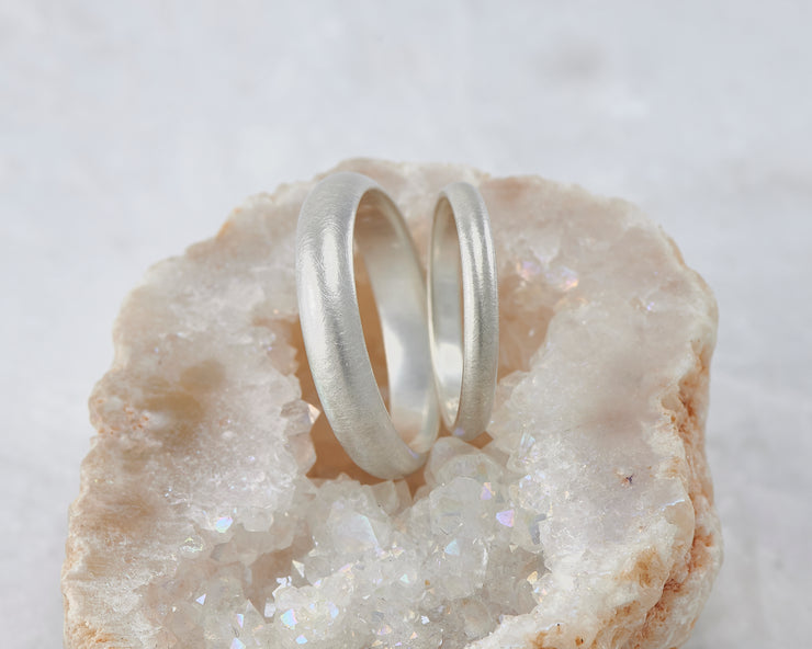 two brushed wedding bands in crystal