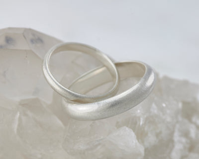 brushed Wedding bands set on crystal rock