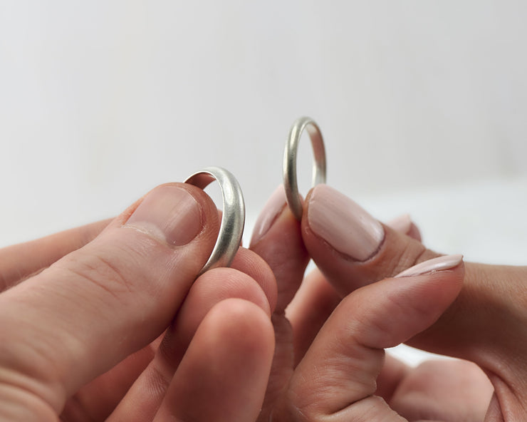 his and hers wedding ring on man and woman's hands