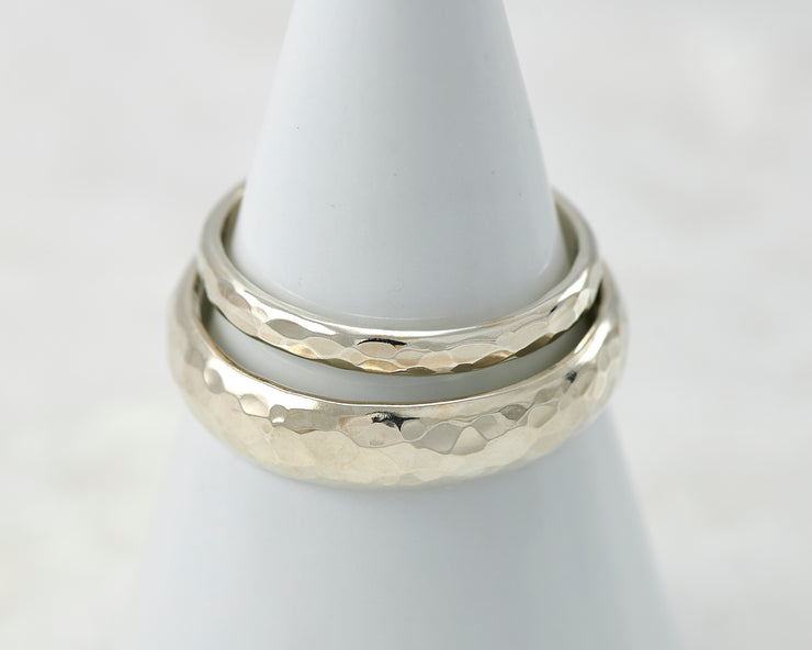 two wedding bands on white ring holder