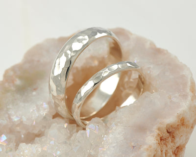 Wedding bands set resting in crystal rock