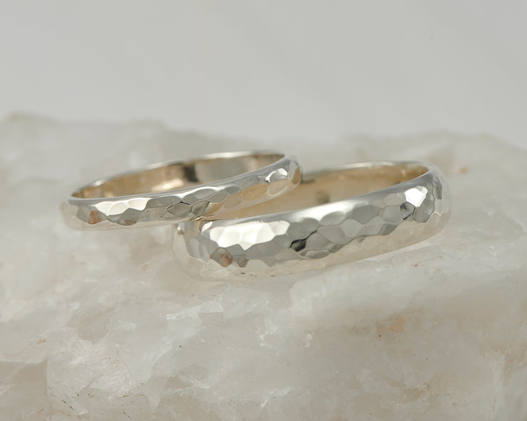 wedding ring set on white rock