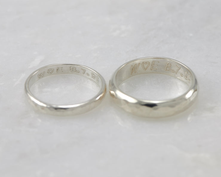 Two wedding bands showing custom engraving