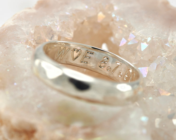 close up of wedding band custom engraving