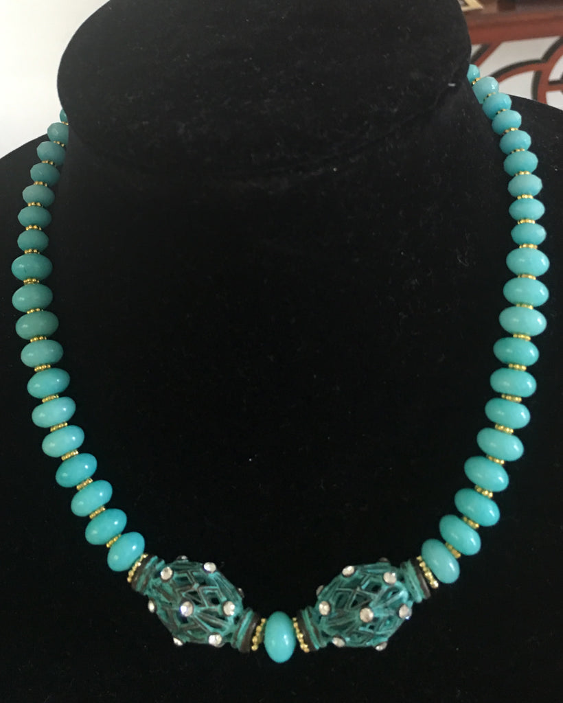 Turquoise Colored Necklace with 2 Oval Shaped Blue Plated Patina Metal Accents with Rhinestones and Gold Accents