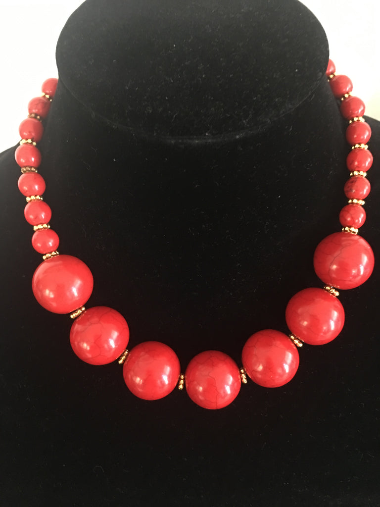 Red Necklace with Large Stones and Gold-Tone Accents.