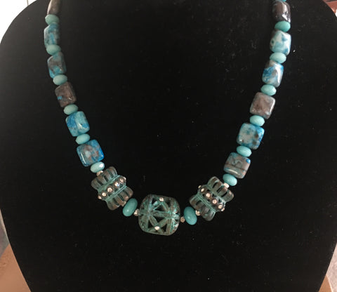 Turquoise Colored Flat Agate with 3 Blue Patina Plated Metal Accents with Rhinestones.