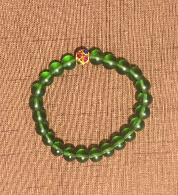 Green Polished Glass with Multicolored Rhinestone Accents.
