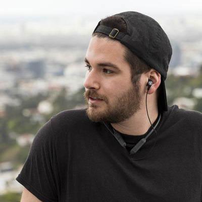 Guy wearing JBuds Band Wireless Neckband Headset