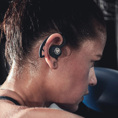 Close-up of Woman Wearing Black Epic Air Elite True Wireless Earbuds