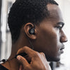 Man wearing Fit Sport 3 Wireless Fitness Earbuds