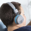 Image of boy wearing the JBuddies Studio Bluetooth Over Ear Folding Kids Heaphones in Blue