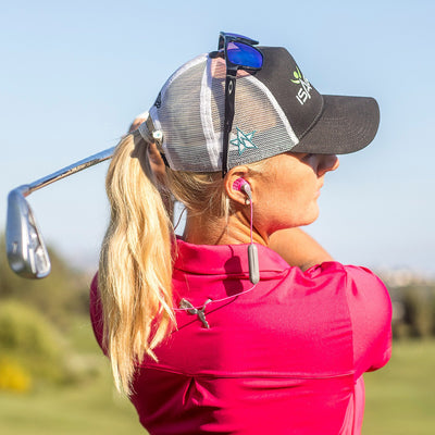 Golfer wearing JBuds Pro Bluetooth Signature Earbuds