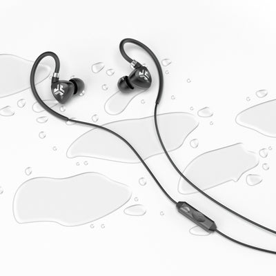 Flat Lay of Black Fit 2.0 Sport Earbuds in Water Drops