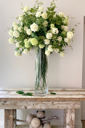Clematis Leaf and Guelder Rose in a Tall Glass Cylinder