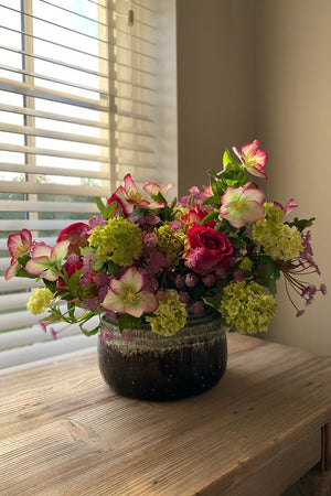 Hellebores, Roses and Greenery in a Two tone Vase
