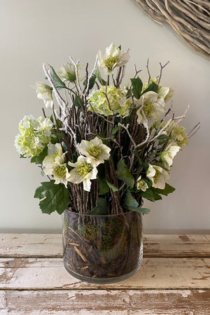 Hellebores, Guelder Rose and Twig in a Glass Cylinder