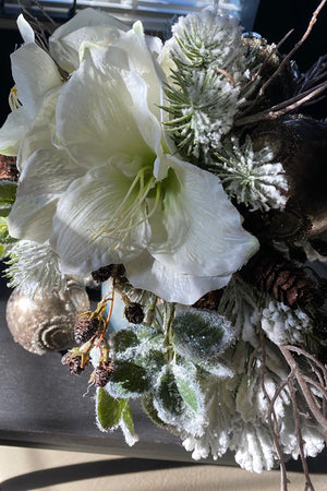 Amaryllis, Flocked Pine and Cones in a Bronze Silver Vase