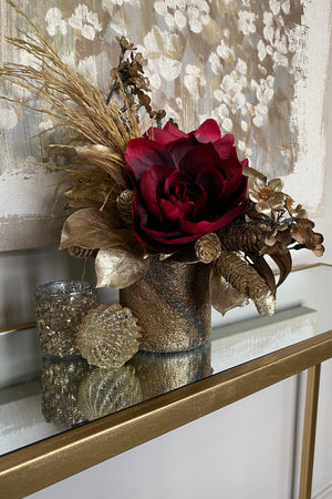 Amaryllis, with Gold Foliage in a Bronze Vase