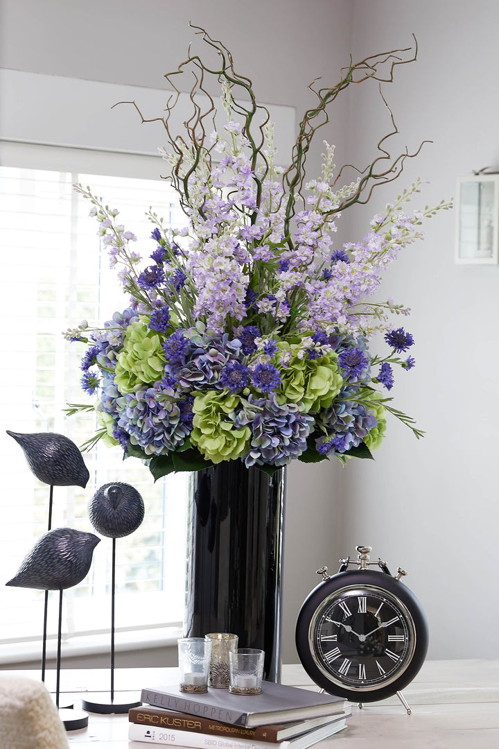 Hydrangeas, Delphiniums and Cornflowers in a Black Glass Vase