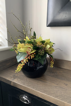 Orchids, Berries and Greenery in a Black Goldfish Bowl