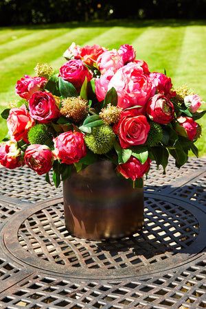 Peony, Rose and Skimmia in a Bronze Vase