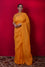 Orangish Yellow Pure Organza Saree with Rangoli Pattern on Pallu + Bandhej Blouse