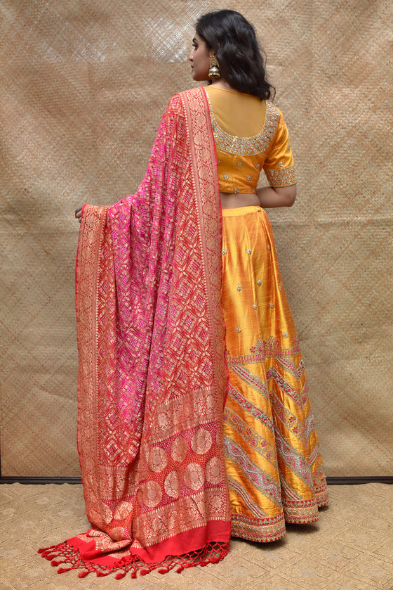 Bright Orange Raw Silk Lehenga Set with Banarasi Bandhani Dupatta