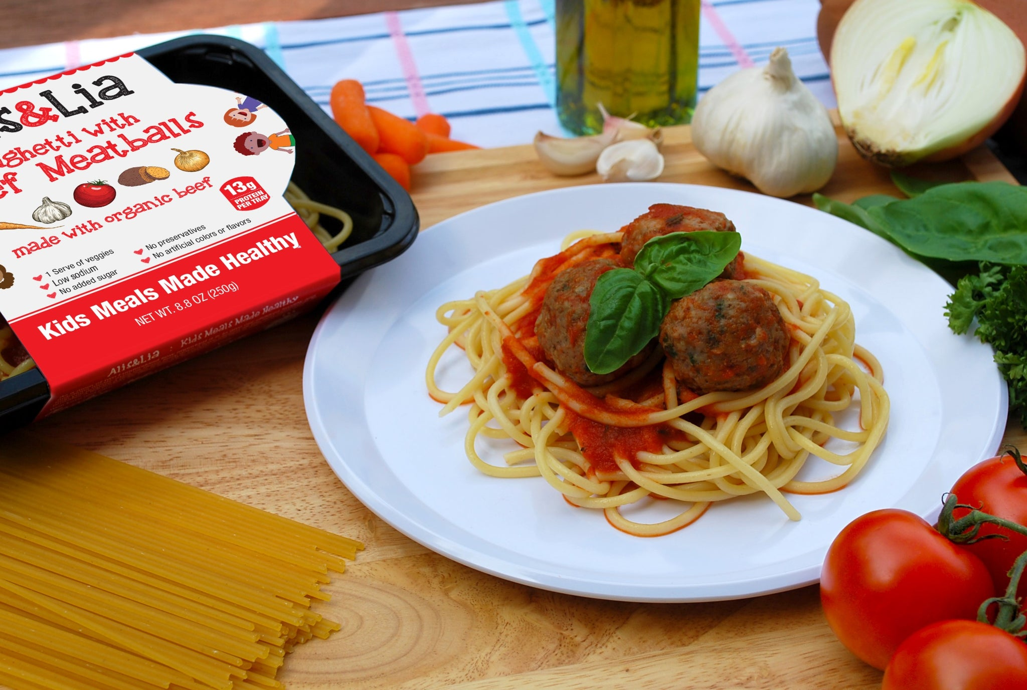 kids meals beef meatballs and spaghetti fresh vegetables