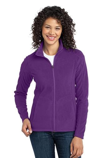 A front view of a woman wearing ladies Port Authority purple microfleece jacket