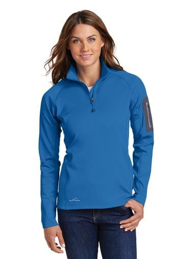 A front view of a woman wearing blue Eddie Bauer ladies zip performance fleece jacket