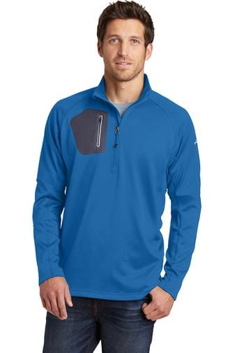 A front view of a man wearing blue Eddie Bauer zip performance fleece jacket