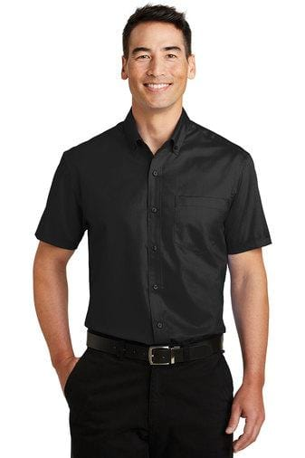 A front view of a man wearing Port Authority men's black short sleeve SuperPro twill shirt