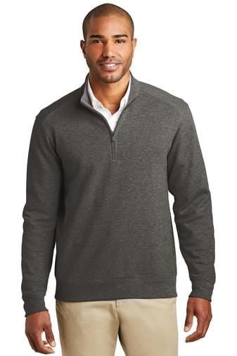 A front view of a man wearing charcoal grey heather Port Authority Interlock 1/4 zip jacket