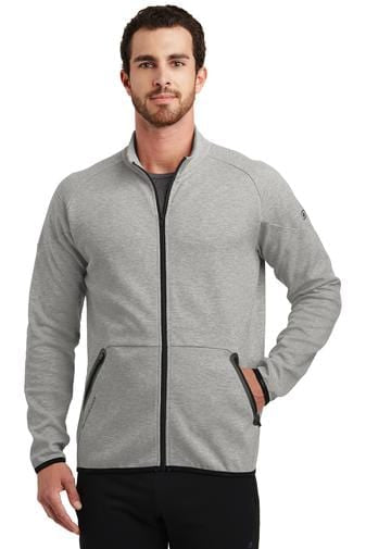 A front view of a man wearing aluminum grey Ogio men's Endurance Origin jacket