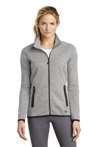 A front view of a woman wearing aluminum grey Ogio ladies Endurance Origin jacket