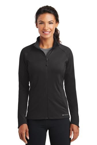 A front view of a woman wearing blacktop Ogio ladies Endurance Radius full-zip jacket