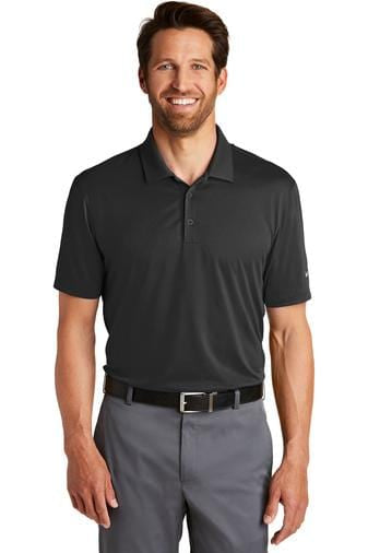 A front view of a man wearing black Nike men's dri-fit legacy polo shirt